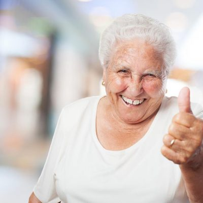 happy old woman with thumb up closeup